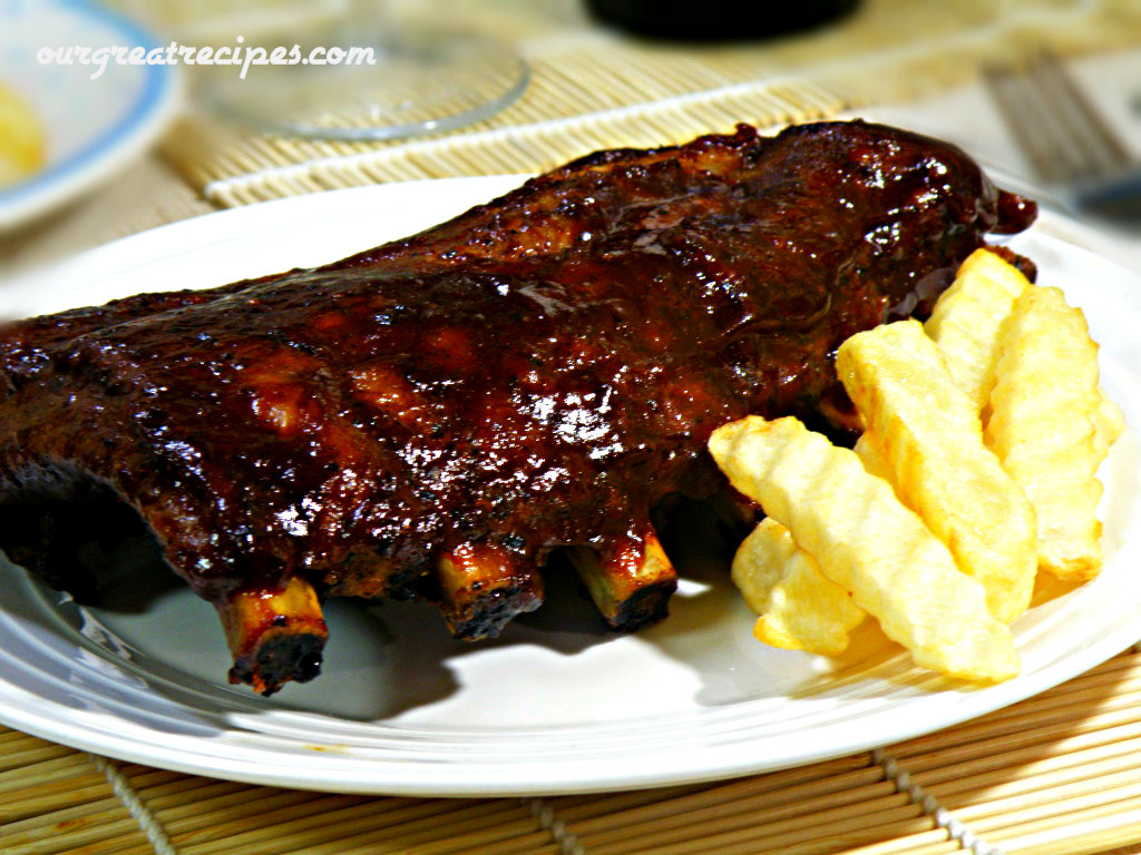 How to bake pork ribs in the oven, so it was delicious